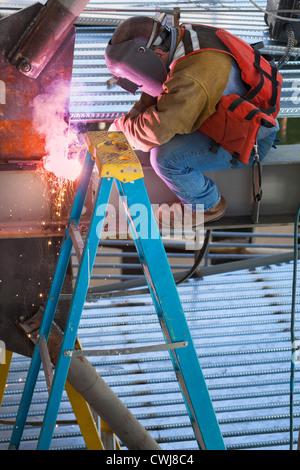 Construction Worker welding metal