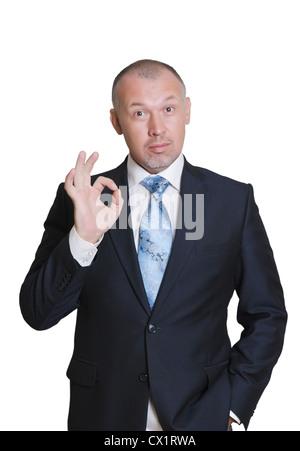 """Homme dans un costume d'affaires montre doigts signe """"OK"""" Banque D'Images"""