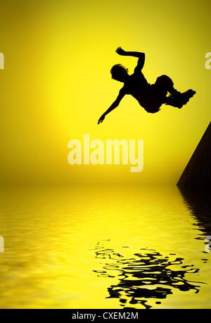 Rouleau de silhouette garçon sautant dans l'air Banque D'Images