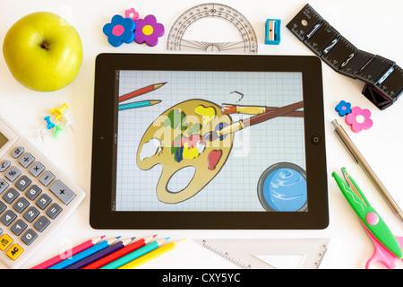 Peinture sur Ipad 3 avec les accesoires sur fond blanc Banque D'Images