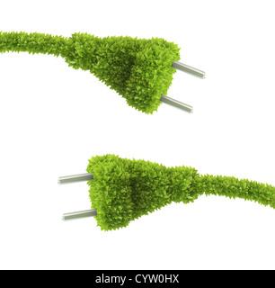 Prise électrique couverte d'herbe - concept d'énergie renouvelable Banque D'Images