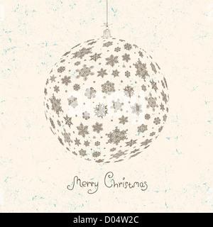 Boule de Noël sur fond beige texturé. Banque D'Images
