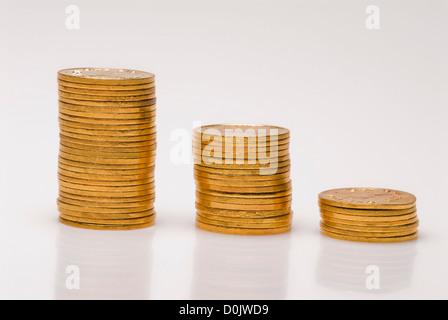 Des piles de pièces d'or Banque D'Images