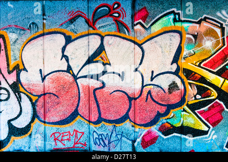 Street art graffiti tag sur un mur, UK Banque D'Images