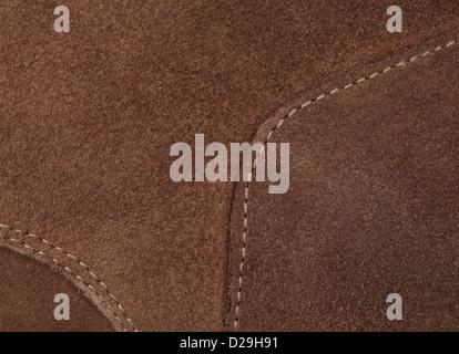 La photo en gros plan de cuir brun clair à haute résolution. Trois morceaux de nubuck piqué avec fil de lumière. Banque D'Images