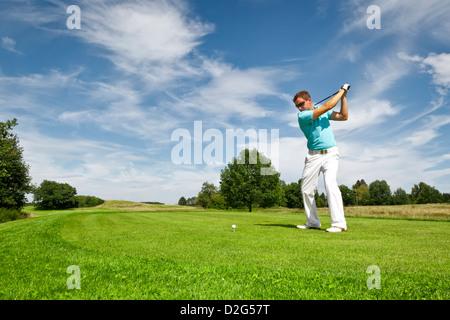 L'image d'un jeune joueur de golf Banque D'Images