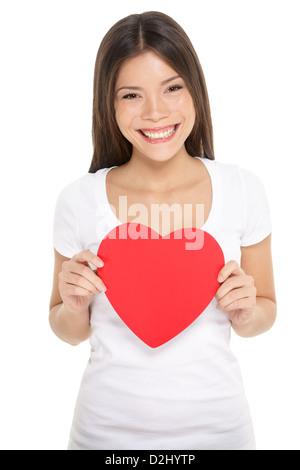 Portrait of happy mixed race asiatique chinois / Caucasian woman coeur isolé sur fond blanc Banque D'Images