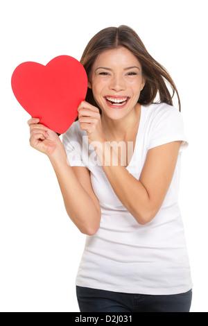 Portrait de joyeux mixed race asiatique chinois / Caucasian woman coeur isolé sur fond blanc Banque D'Images