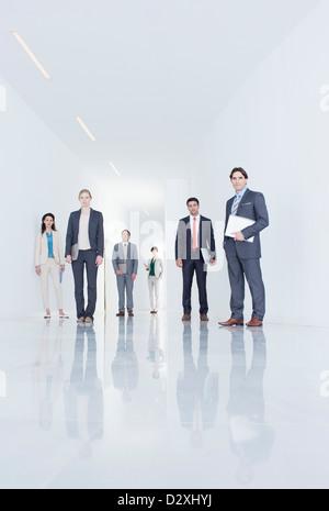 Portrait of business people in corridor