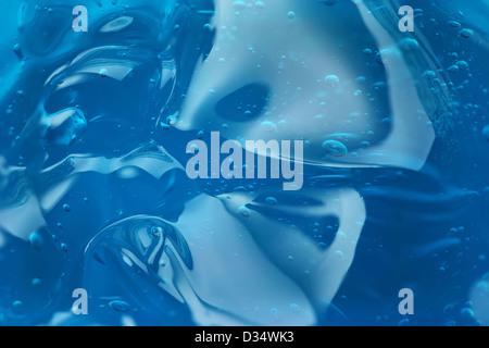Bulles dans le gel bleu abstrait Banque D'Images