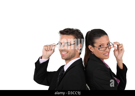 Business couple wearing glasses Banque D'Images