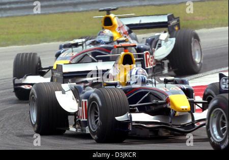 (Afp) - Colombie Britannique pilote de Formule 1 David Coulthard (avant) et son coéquipier autrichien Christian Banque D'Images