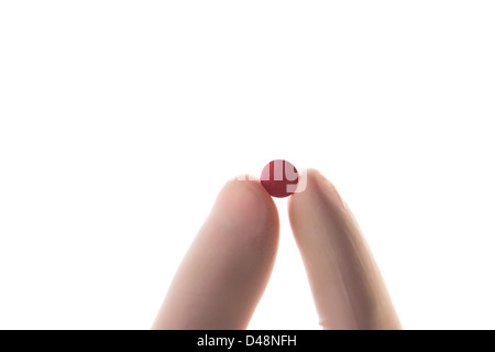 Gloved hand holding red tablet Banque D'Images