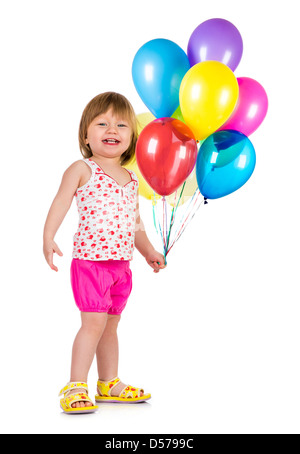 Little girl smiling with balloons sur fond blanc Banque D'Images