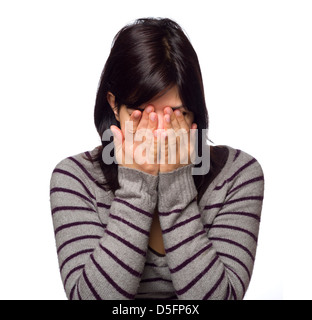 Portrait of young woman with hands covering face