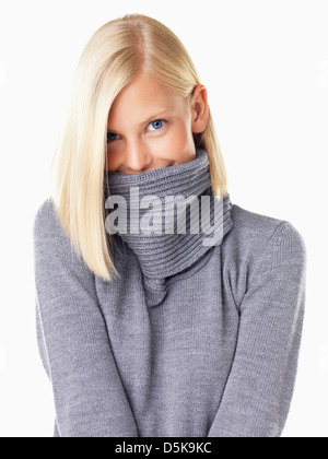Studio portrait of young woman wearing gray sweater Banque D'Images