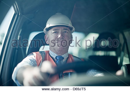 Businessman driving in car Banque D'Images