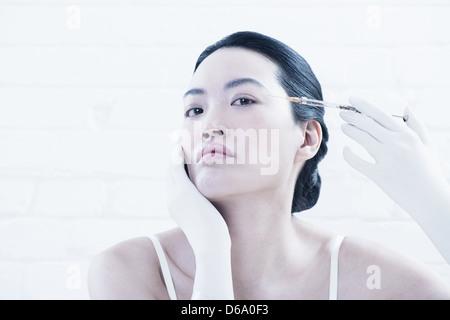 Woman having Botox injection en face
