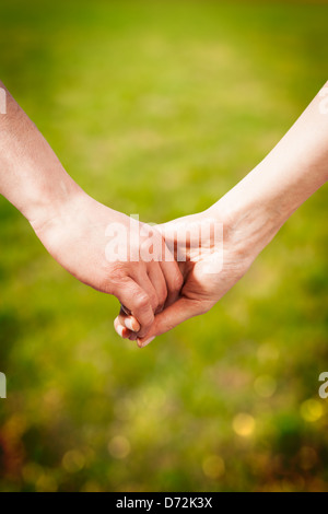 Close-up Holding Hands Banque D'Images