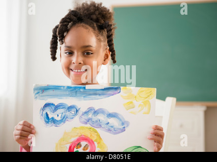 African American Girl with painting in classroom