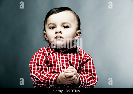 Portrait of baby boy wearing chemise à carreaux Banque D'Images