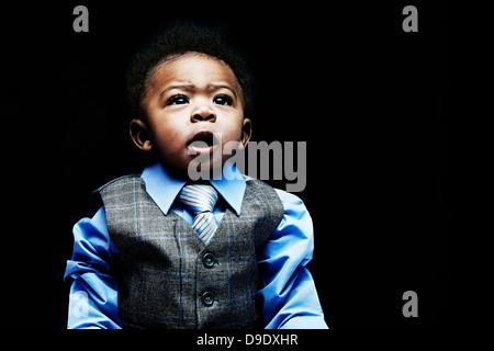 Portrait of baby boy wearing gilet, chemise et cravate Banque D'Images
