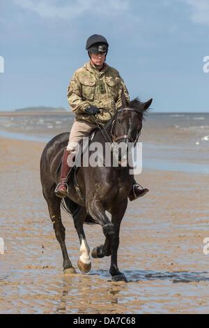 Holkham, Norfolk, Royaume-Uni. 4 juillet, 2013. La cavalerie de famille - un agent de la circonscription de sauveteurs Banque D'Images