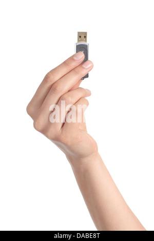Woman hand holding up un lecteur flash isolé sur fond blanc Banque D'Images