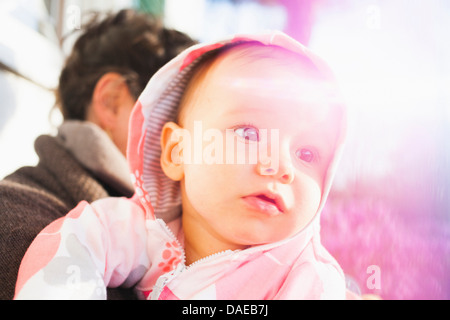Close up portrait of baby girl wearing hood Banque D'Images