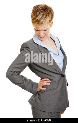 Femme d'affaires d'une douleur au holding main sur son dos Banque D'Images
