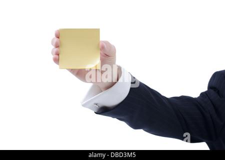 Businessman holding a stick jaune note de rappel isolé sur fond blanc Banque D'Images