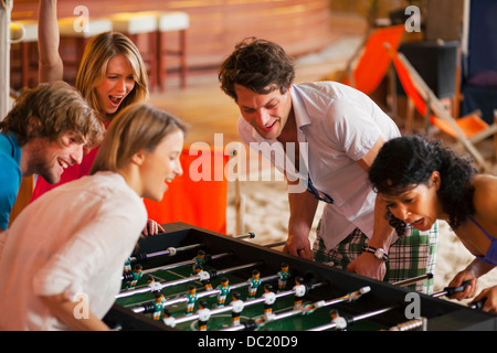 Friends having fun playing table football Banque D'Images