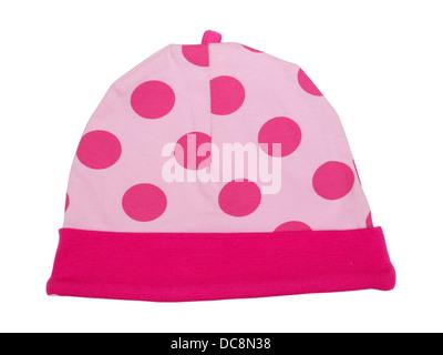 Bonnet bébé rose à pois sur fond blanc Banque D'Images