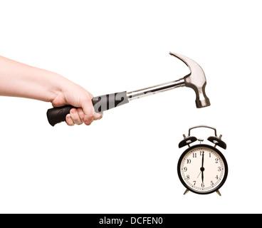 Réveil et le marteau à la main Banque D'Images
