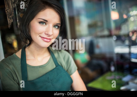 Portrait of teenage girl in cafe