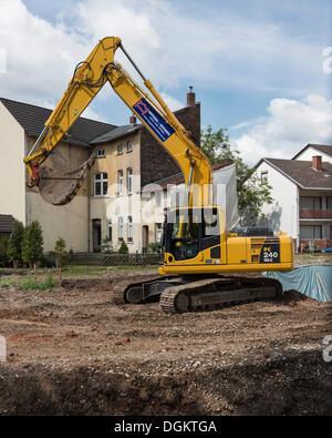 La construction, la terre d'excavation de la pelleteuse à Bonn, Rhénanie du Nord-Westphalie, PublicGround