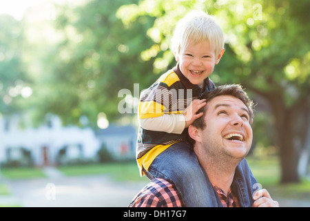 Woman carrying son on shoulders