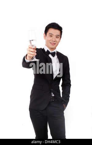 Man in tuxedo holding a glass of champagne