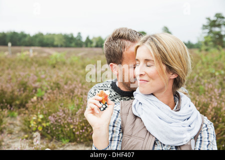 Couple, woman smiling with eyes closed Banque D'Images