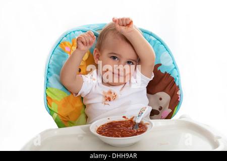 Repas bébé mess Banque D'Images