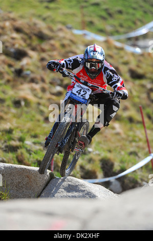 Vtt Downhill Racer Steve Peat participe à la Coupe du Monde de vélo de montagne UCI, Fort William en 2013. Banque D'Images