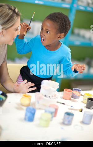 Little girl Playing with teacher in class Banque D'Images