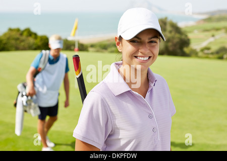 Smiling woman on golf course
