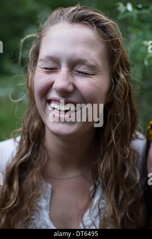 Woman Laughing with eyes closed Banque D'Images