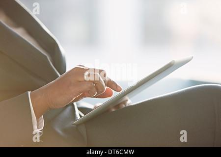Businesswoman using digital tablet, Close up