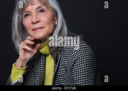 Studio portrait of attractive senior woman