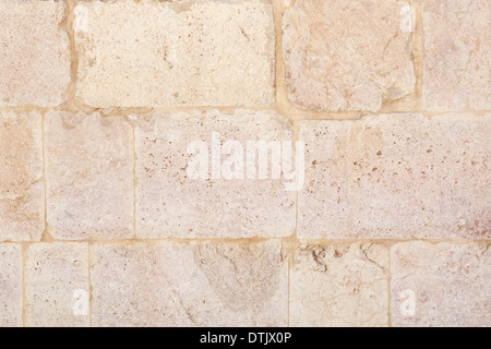 Ancien mur en pierre rose texture background Banque D'Images