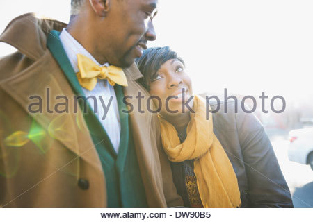 Affectionate couple standing outdoors Banque D'Images