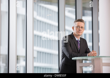 Portrait of businessman standing in office