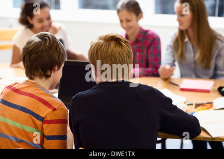High school students using laptop in classroom Banque D'Images
